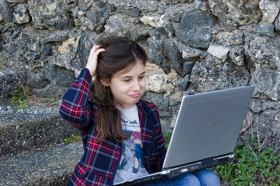 Girl Confused with Laptop